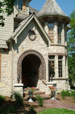 Traditional Front of Home with Brick steps, Arched entry, Rustic pine shutter (custom) - timberlane.com, Round room