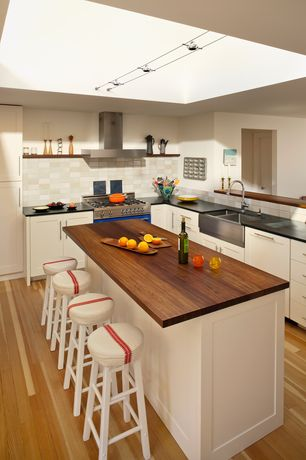 Contemporary Kitchen with Large Ceramic Tile, Farmhouse sink, Flush, L-shaped, Skylight, Wood counters, Kitchen island