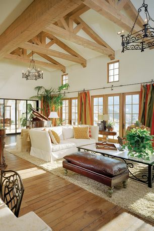 Eclectic Great Room with Chandelier, Natural light, Cathedral ceiling, Oak - natural 2 1/4 in. solid hardwood strip, Paint