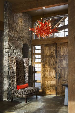 Eclectic Entryway with Natural stone archway, Exposed beam ceiling, Custom deer antler chandelier, Flagstone flooring