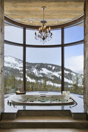 Rustic Master Bathroom with Arizona tile, APHRODITE, granite, can lights, specialty window, drop in bathtub, Chandelier