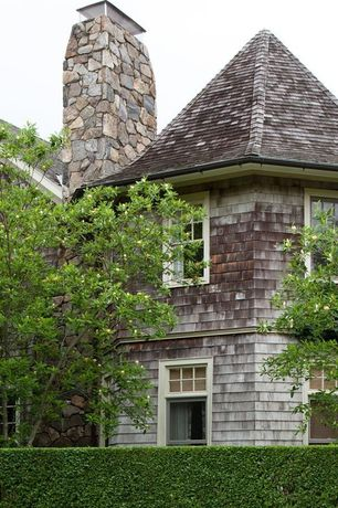 Cottage Exterior of Home with Wood shingle siding, Exterior stone chimney