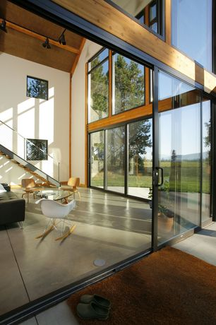 Contemporary Great Room with Concrete floors, Cathedral ceiling