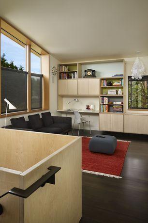 Modern Family Room with Standard height, Casement, Built-in bookshelf, double-hung window, Laminate floors