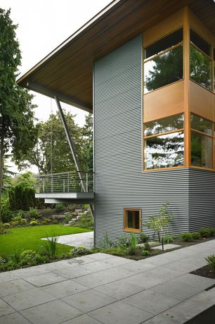 Contemporary Patio with exterior concrete tile floors, Pathway, picture window, Casement, Deck Railing, Fence