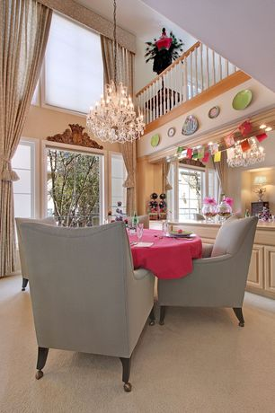 Traditional Dining Room with picture window, Paint 2, Loft, Double tiered chandelier, Birch cabinets, Velvet mobile armchairs