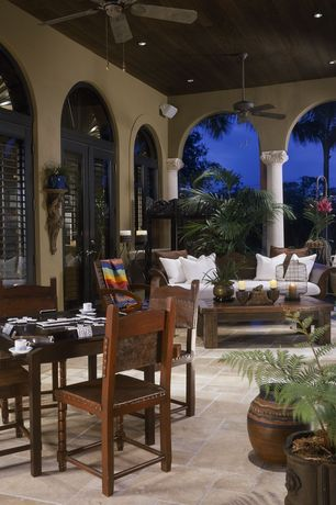 Traditional Patio with Transom window, exterior tile floors, exterior terracotta tile floors, Arched window, French doors