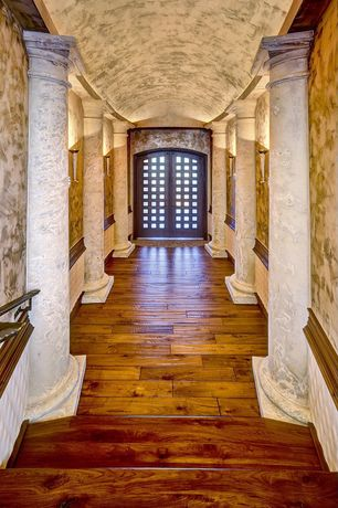 Mediterranean Entryway with High ceiling, Wainscotting, interior wallpaper, Hardwood floors, Wall sconce, Columns