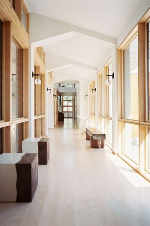 Contemporary Hallway with Globe sconce, Laminate floors, High ceiling, Burl cube table, Wall sconce