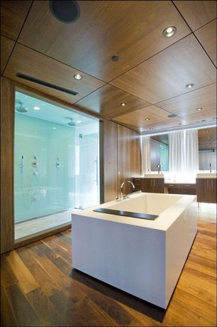 Contemporary Master Bathroom with Rain shower, can lights, Handheld showerhead, Freestanding, Double sink, European Cabinets