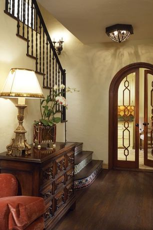 Mediterranean Hallway with flush light, French doors, Standard height, Wall sconce, Hardwood floors