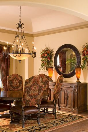 Mediterranean Dining Room with Laminate floors, Standard height, Built-in bookshelf, specialty window, Chandelier