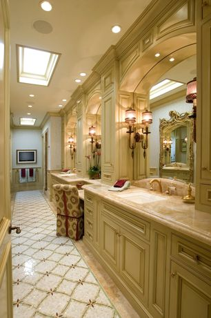 Traditional Master Bathroom with Master bathroom, Concrete floors, Inset cabinets, Complex marble counters, Skylight