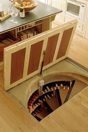 Contemporary Wine Cellar with Hardwood floors, Custom wine storage, Spiral staircase, Standard height, Built-in bookshelf