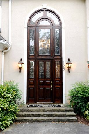 Traditional Front Door with Transom window, Arched window, Glass panel door, exterior stone floors