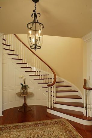 Traditional Staircase with Crown molding, Laminate floors, Chandelier, Wainscotting