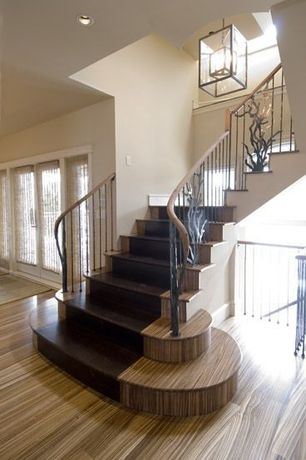 Contemporary Staircase with Pendant light, Laminate floors