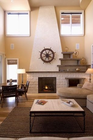 Modern Great Room with Myron coffeetable, Cathedral ceiling, stone fireplace, Laminate floors
