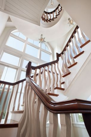 Eclectic Staircase with Spiral staircase, flush light, Arched window, Laminate floors, Cathedral ceiling