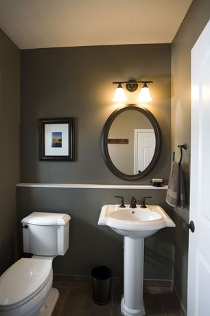 Traditional Powder Room with large ceramic tile floors, Moen T6620 - Oil Rubbed Bronze, Pedestal sink, six panel door, Paint