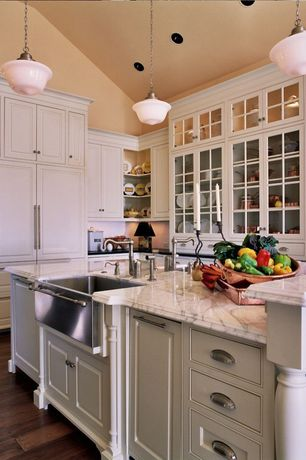 Traditional Kitchen with Complex marble counters, Farmhouse sink, High ceiling, Glass panel, Raised panel, Pendant light