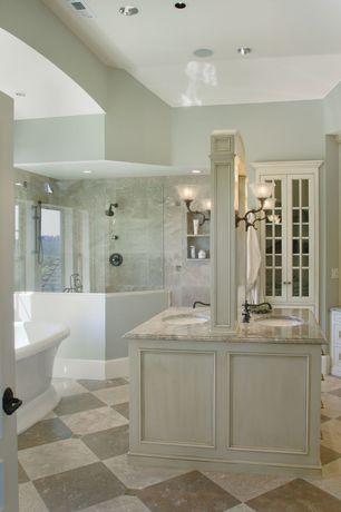 Traditional Master Bathroom with Undermount sink, Complex marble counters, Flat panel cabinets, stone tile floors, Bathtub