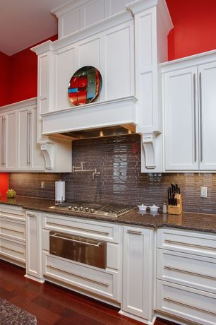 Traditional Kitchen with warming oven, Kitchen island, gas cooktop, High ceiling, Glass Tile, full backsplash, Paint