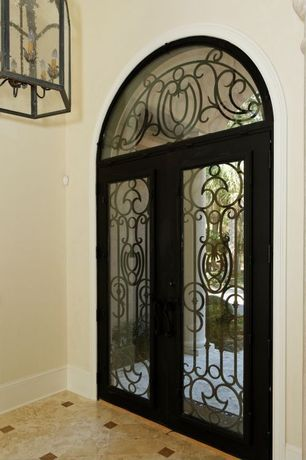 Mediterranean Entryway with Arched window, Glass panel door, Chandelier, High ceiling, travertine floors
