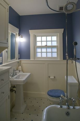 Craftsman Full Bathroom with double-hung window, Pedestal sink, Flush, Wall sconce, Built-in bookshelf, stone slab showerbath