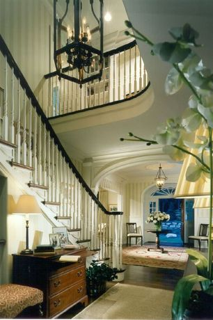 Traditional Staircase with High ceiling, Laminate floors, Chandelier