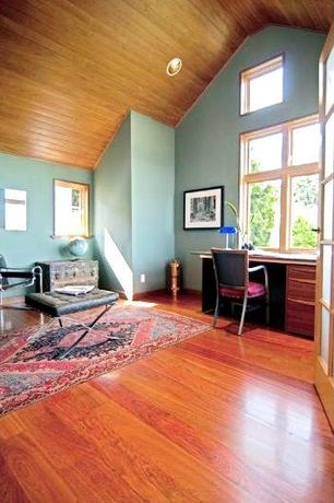 Eclectic Home Office with Hardwood floors, French doors, can lights, picture window, Standard height