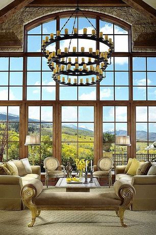 """Mediterranean Living Room with French Carved Armchair, 70""""W Lodge Horizon Ring Jadestone 3 Tier Chandelier"""