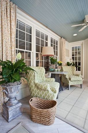 Contemporary Living Room with French doors, Screened porch, Thurston wing chair with pewter nailheads