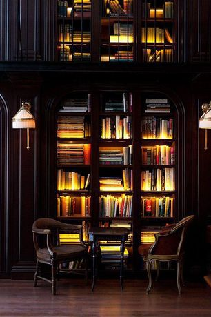 Traditional Library with Antique english mahogany horseshoe pub chair, Antique reading chair, In shelf lighting, Wall sconce