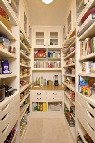 Contemporary Pantry with flush light, Crown molding, Built-in bookshelf, limestone tile floors, stone tile floors