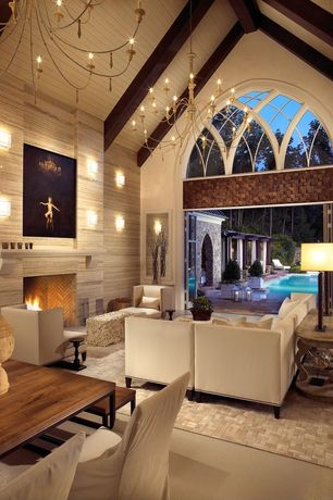 Contemporary Living Room with Cathedral ceiling, Chandelier, interior brick, Fireplace, insert fireplace, Wall sconce