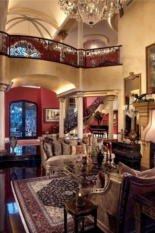 Traditional Living Room with High ceiling, Crown molding, Sunken living room, Columns, Chandelier, complex marble floors