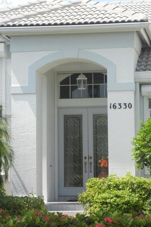 Traditional Front Door with Transom window, French doors, exterior terracotta tile floors, exterior tile floors