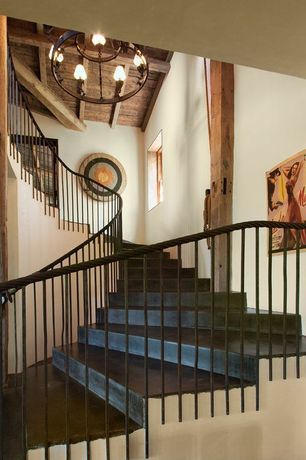 Rustic Staircase with Chandelier, Columns, Exposed beam, High ceiling, Concrete floors