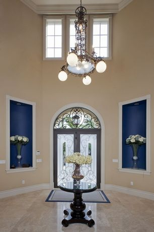 Traditional Entryway with Transom window, Crate & Barrel Esme Bruno Pedestal Table, French doors, Chandelier, Crown molding