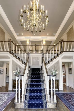 Traditional Staircase with Wall sconce, can lights, Chandelier, Hardwood floors, Loft, High ceiling, Crown molding, Carpet