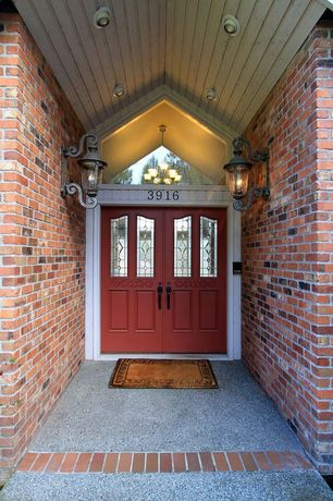 Traditional Front Door with Glass panel door, exterior stone floors, exterior brick floors