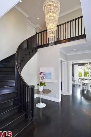 Contemporary Staircase with Crown molding, Hardwood floors, Cathedral ceiling, Chandelier