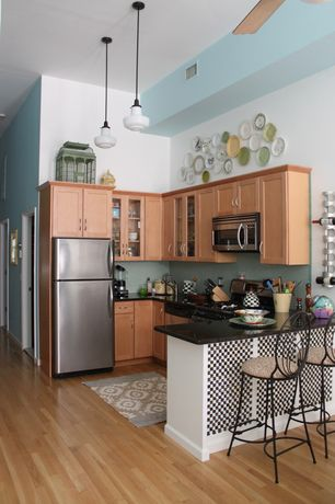 Contemporary Kitchen with European Cabinets, Flat panel cabinets, Stonemark Granite-Granite Countertop in Absolute Black