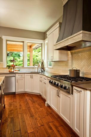 Traditional Kitchen with Flat panel cabinets, Casement, Chevron tile back splash, Kitchen island, full backsplash, dishwasher