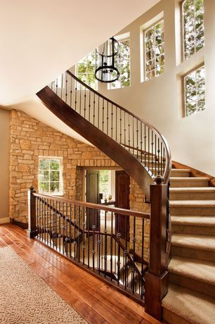 Traditional Staircase with Hardwood floors, Cathedral ceiling, interior brick, Carpet