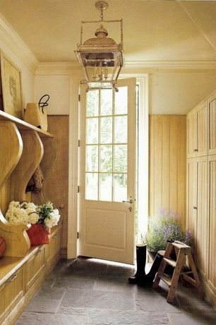 Traditional Mud Room with Built-in bookshelf, Lantern pendant chandelier, Glass panel door, High ceiling, slate floors