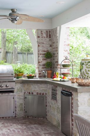 Traditional Patio with Outdoor kitchen and grill, Mini refrigerator, Exposed brick, Concrete counters, outdoor pizza oven
