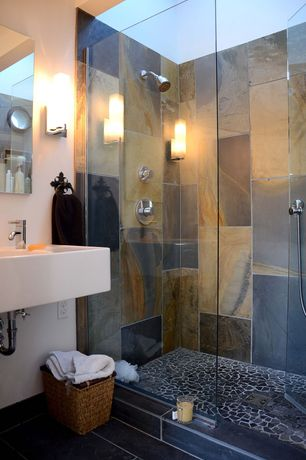 Contemporary Master Bathroom with Handheld showerhead, Wall mounted sink, frameless showerdoor, Wall sconce