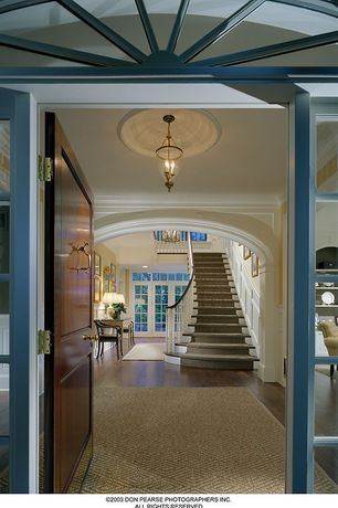 Traditional Entryway with Pendant light, Wainscotting, Laminate floors, Exposed beam, Glass panel door, Transom window